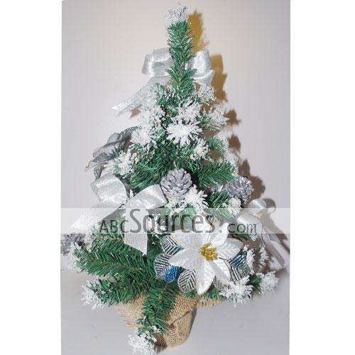 nice mini christmas tree with white flower decoration