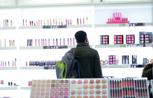 businessman choosing cosmetics in yiwu market